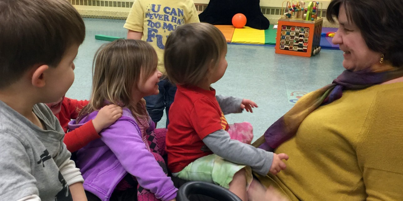 Executive Director Deb Green playing with toddlers