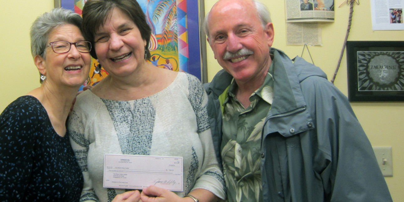 Marcy and Jim Lily present Executive Director Deb Green with a check from Cindy Days