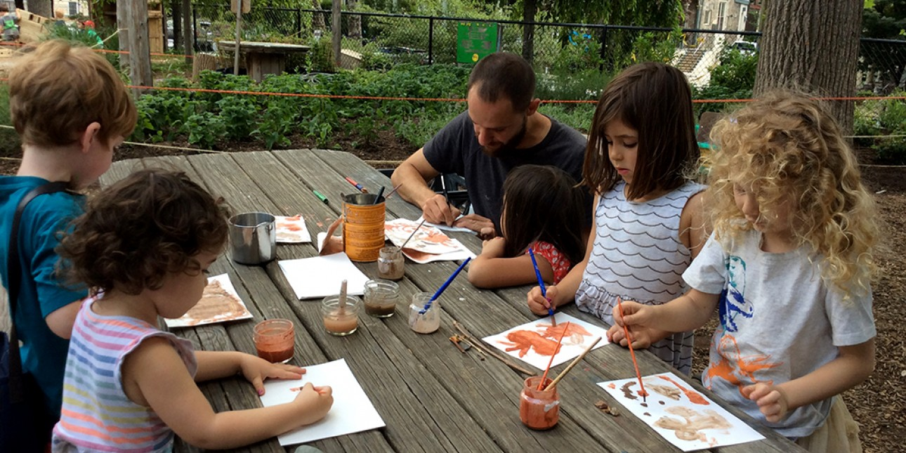 nature educator leads painting with clay activity