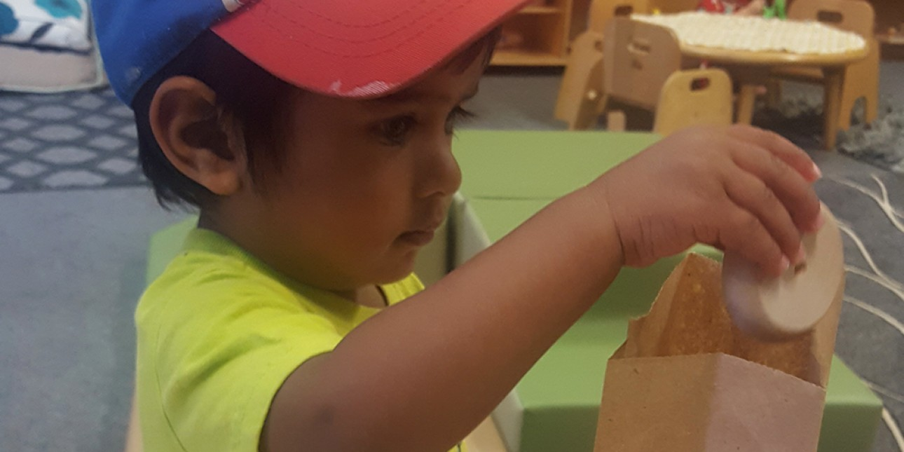 PIC young toddler interacting with paper bag